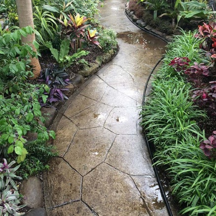 30 Walkway Ideas For Inspiration | Green and Vibrant in 2020 | Landscaping  with rocks, Concrete garden, Front yard landscaping