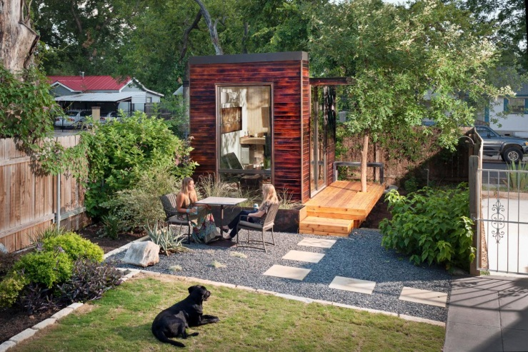 Backyard With Home Office Studio and Cafe Table | HGTV