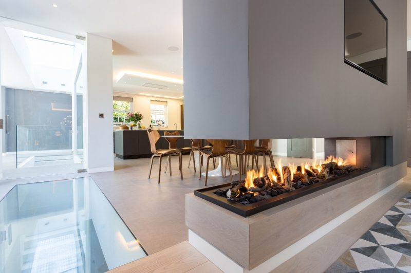 This stunning three sided gas fireplace forms part of a room divider. |  Modern fireplace, Contemporary gas fireplace, Double sided gas fireplace