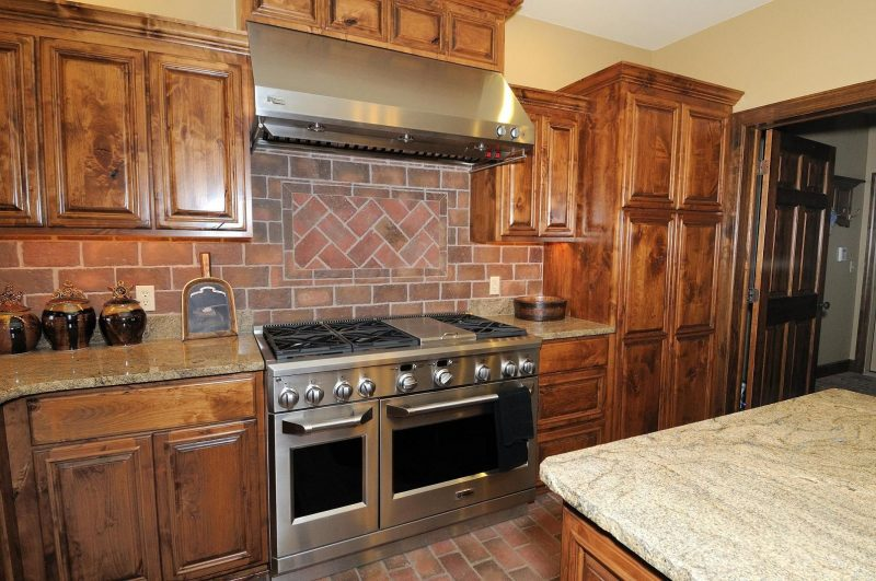 King Street brick tile kitchen floor and back splash, Providence color mix.  | Brick backsplash, Rustic kitchen backsplash, Brick backsplash kitchen