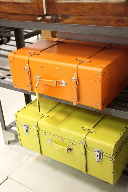 Orange You Glad I Went to the NYIGF? | Ellegant Home Design | Painted trunk,  Suitcase storage, Colorful suitcases